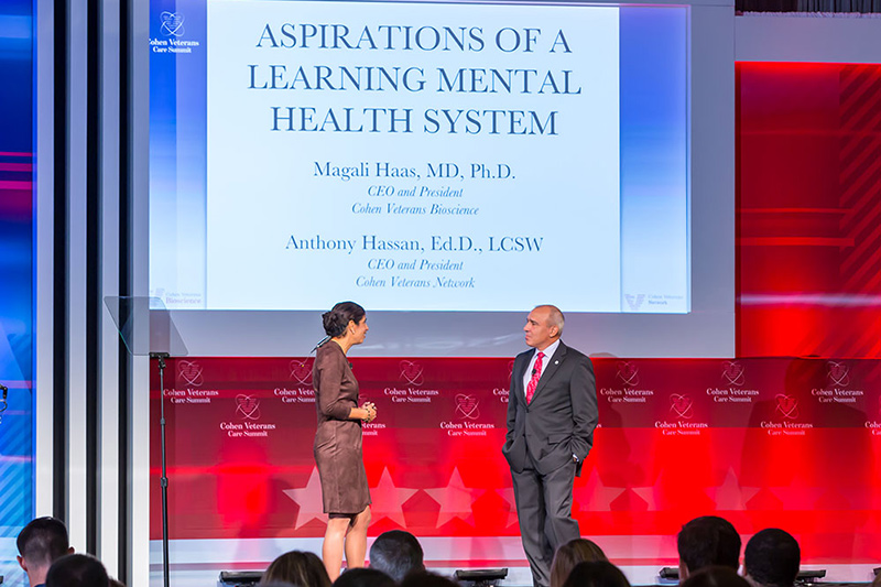 Magali Haas, MD, PhD, and Anthony Hassan, EdD, LCSW, speaking at the 2018 Cohen Veterans Care Summit